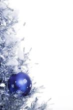 Snowflake Christmas Ornament Hanging On Tree