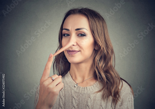 A liar woman with long nose Canvas Print