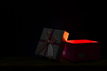 Gift Box In The Dark With Copy Space For Text.