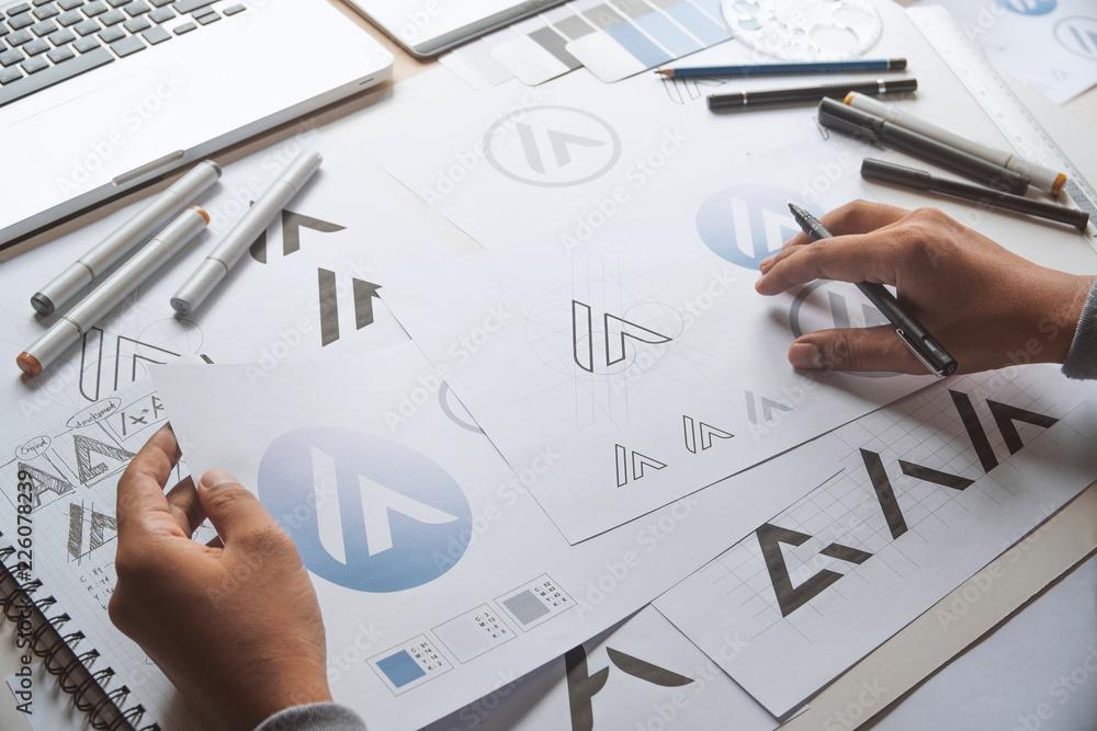 Fototapety, obrazy: Graphic designer development process drawing sketch design creative Ideas draft Logo product trademark label brand artwork. Graphic designer studio Concept.