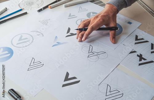 Graphic designer development process drawing sketch design creative Ideas draft Logo product trademark label brand artwork. Graphic designer studio Concept.