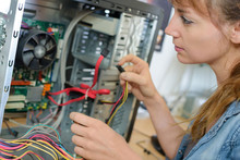 Young Lady Rewiring Computer