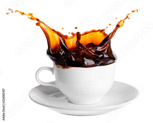 Fototapeta Black coffee splash out of a cup isolated on white background. obraz