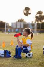 A Soccer Player Takes A Break For Water.