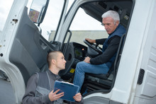 Senior Truck Driver Taking To Manager