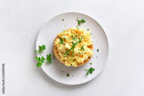 Scrambled eggs on bun