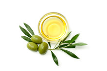 Glass Bowl With Olive Oil, Big Olives And Leafs. Close-up, Isolated On White Background