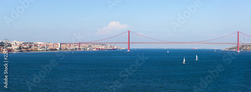 Panorama view over the 25 de Abril Bridge. The bridge is connecting the city of Lisbon to the municipality of Almada on the left bank of the Tejo river, Lisbon