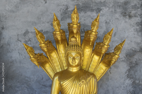 Close-up of Buddha statue against wall in temple