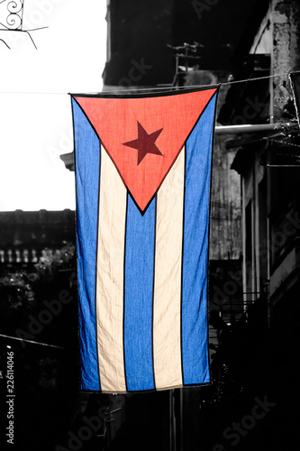 Cuban flag  on a black and white aged Old Havana building Wallpaper Mural