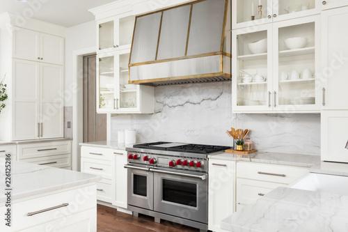 Obraz White Kitchen Detail  in New Luxury Home: Oven, Range, Hood, and Countertops - fototapety do salonu