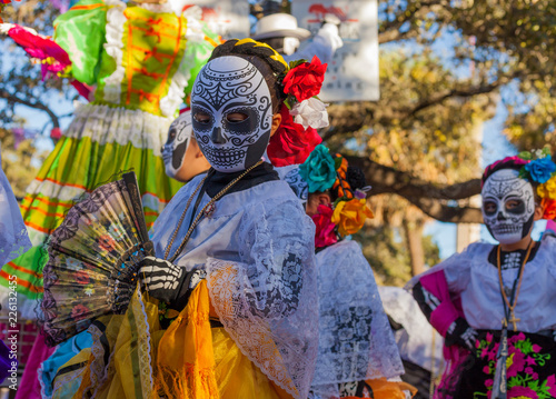 Group of unrecognizable women wearing traditional sugar skull masks and costumes Wallpaper Mural