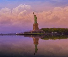 The Statue Of Liberty In New York City, Statue Of Liberty With Cloudy Sky