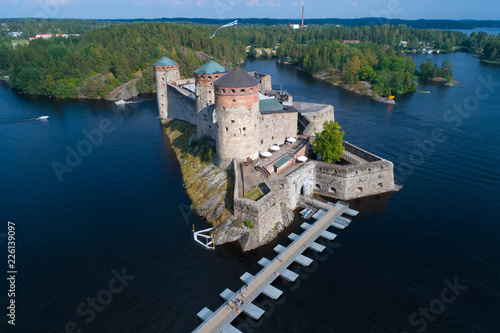In de dag Noord Europa Ancient fortress of the Savonlinna city on a sunny July afternoon (aerial photography). Finland