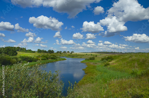 Fotobehang Rivier Sunny summer landscape with river,fields,green hills and beautiful clouds in blue sky.River Upa in Tula region,Russia.