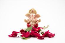 Lord Ganesha Idol With Rose Petals On White Background, Ganesh Chaurthi, Ganesh Pooja