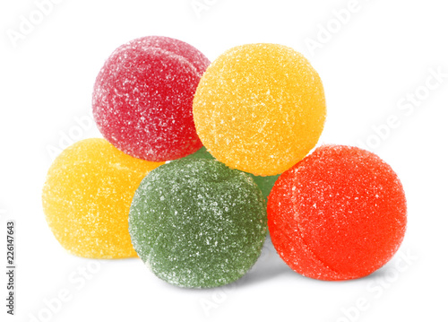 Delicious colorful chewing candies on white background