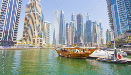 boats and modern buildings in Dubai Marina, United Arab Emirates