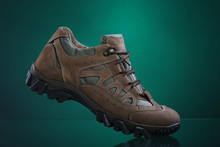 Hiking Boot On Green Background