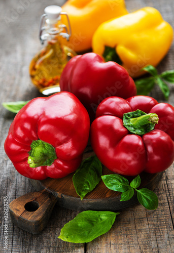 Bell peppers on a wooden background Fototapet
