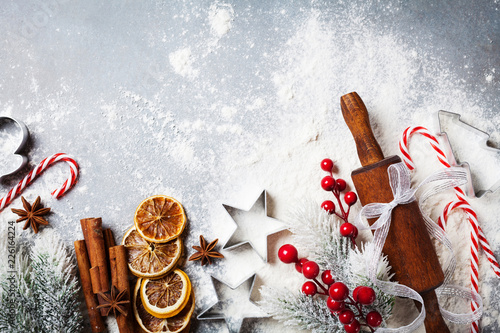 Canvas Print Bakery background for cooking christmas baking with rolling pin, scattered flour and spices decorated with fir tree top view