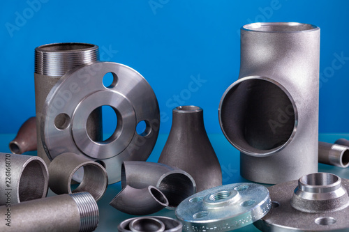Set of steel welding fittings like tees, elbows, flanges, reducers, sockets, nipples, cups and others Fototapete