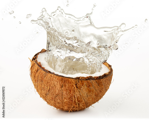 water splashing from a coco nut isolated on white