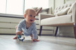 canvas print picture - little baby boy crawling on floor at home