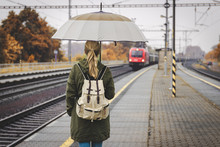 Young Woman Waiting For Train ...