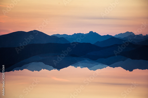 Colorful, abstract double exposure of mountains in sunrise. Minimalist scenery with color gradients. Tatra mountains in Slovakia, Europe. #226175064