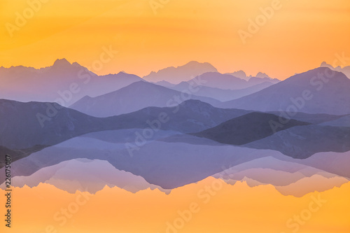 Colorful, abstract double exposure of mountains in sunrise. Minimalist scenery with color gradients. Tatra mountains in Slovakia, Europe. #226175087