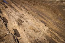 Deep Car Rut On A Dirt Road