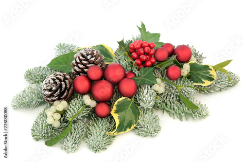 Christmas Table Decoration With Red Bauble Decorations Holly