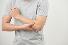 Arms Pain. Man Suffering From Painful Feeling In Arm Muscles. Health Concept