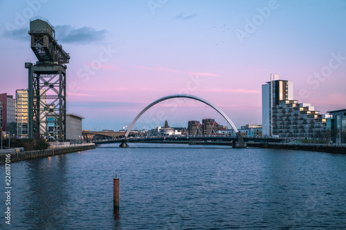 Sunset view of the Clyde Arc or Squinty Bridge and river Clyde, Glasgow, Scotland