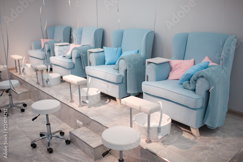 Poster Pedicure Chairs in a pedicure beauty salon