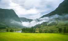 A Beautiful Green Mountain Valley Near Rosendal In Norway. Autumn Landscape In Folgefonna National Park. Overcast Day.