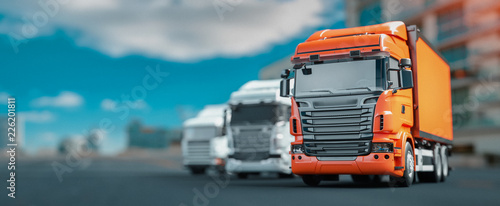 Orange and white truck parked in the city.