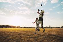 American Football Player Catch...