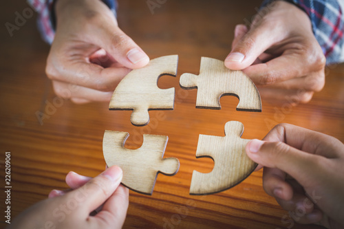 Fotografie, Tablou  Hands of diverse people assembling jigsaw puzzle, Youth team put pieces together