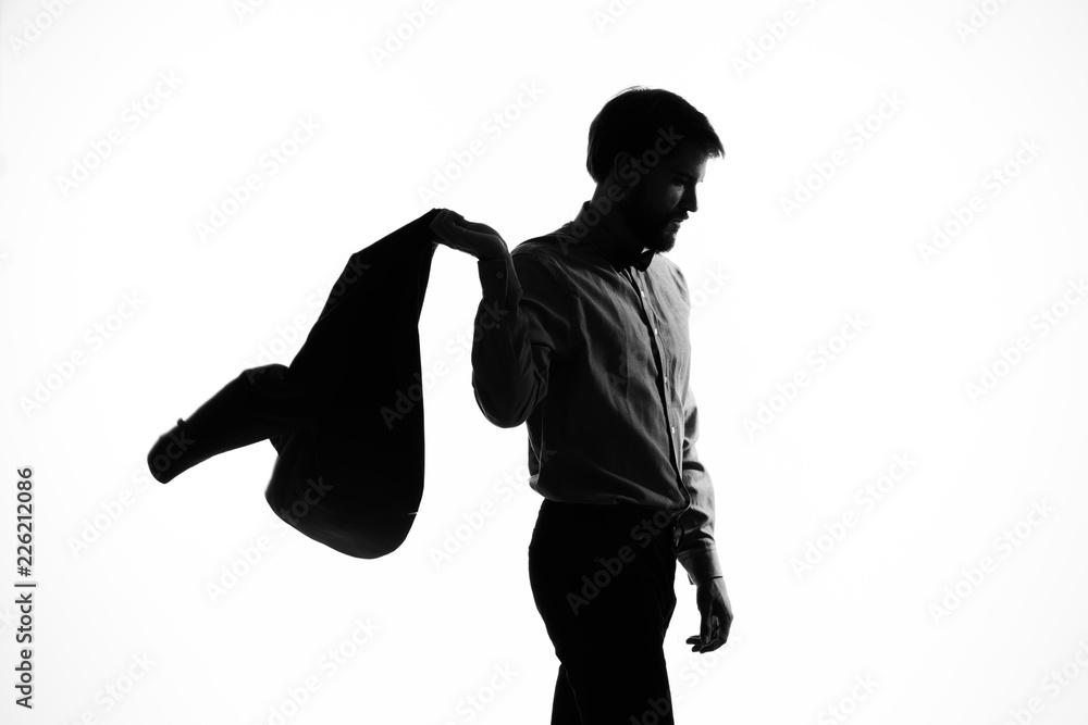 Fototapeta business man with a jacket shadow