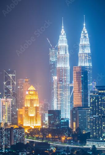 Spoed Foto op Canvas Stad gebouw Cityscape of Kuala lumpur city skyline at night in Malaysia.