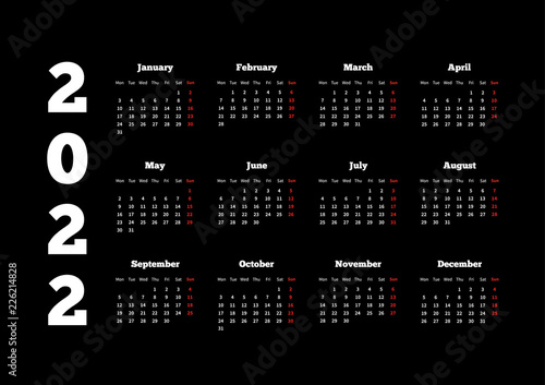 Fotografia  Calendar on 2022 year with week starting from monday, A4 sheet on dark backgroun