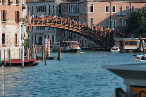 Photo  Venice, Italy - September 15, 2018 - The River Tram sailing under the Academy Br
