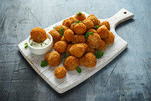 Homemade Breaded Garlic Mushrooms With Sour Cream And Parsley On White Wooden Board