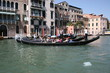 Gondola on canal in Venice, buildings in background Italy