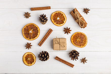 Kraft Paper Gifts And Spices On A White Table. The Original Decor For Christmas. Beautiful Layout, Top View, Flat Lay.
