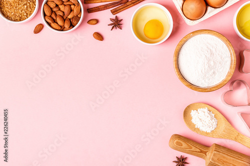 Obraz Ingredients and utensils for baking on a pastel background. - fototapety do salonu