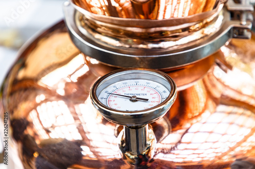 The thermometer on a copper pot for distillation of alcohol Wallpaper Mural