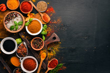 Spices And Herbs On A Wooden B...